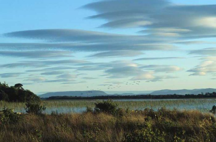 Lenticular clouds over lake, Moorehall by Lynda Huxley
