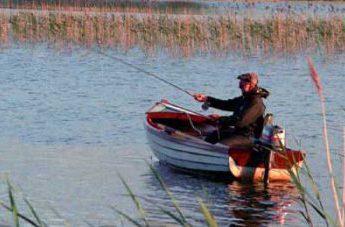 Fishing on Lough Carra by Lynda Huxley