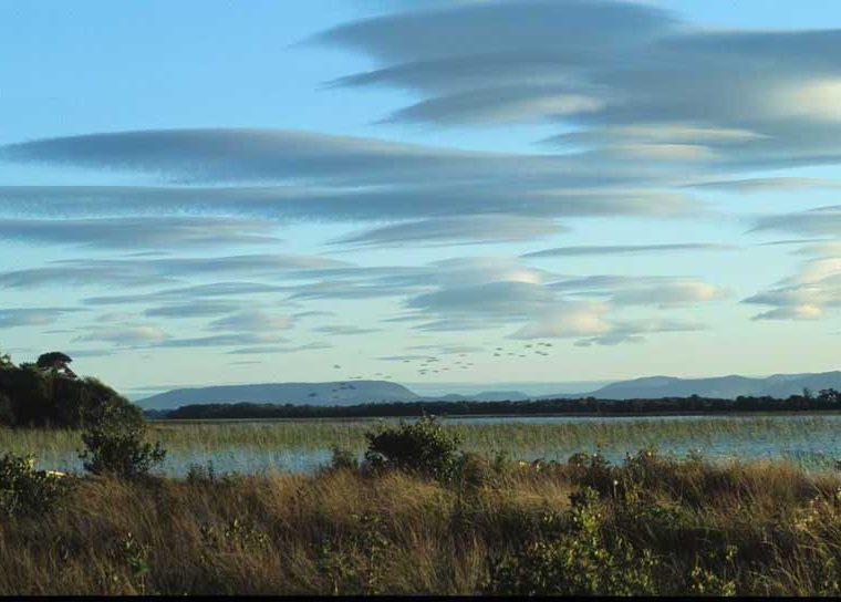 Lenticular clouds over lake, Moorehall by Lynda Huxley