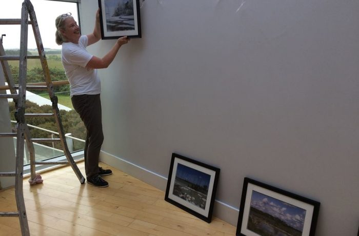 Hanging Dierdre Walsh's paintings ready for the Exhibition at Ballycroy